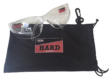 Photo of Pair of clear safety glasses with black pouch and TTP HARD drills logo